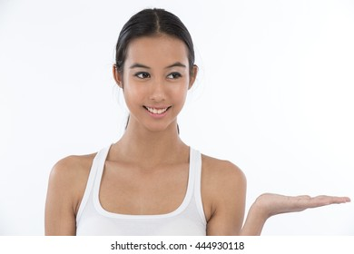 Portrait of a teenage girl presenting imaginary object in her hand