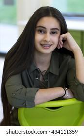 Portrait of a teenage girl at school.