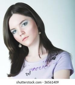 portrait of teenage girl. studio shot.