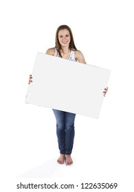 Portrait of a teenage girls holding a blank placard over white background.