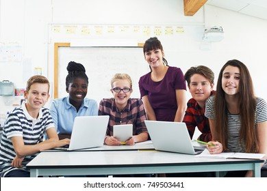 Portrait Of Teenage Students With Teacher In IT Class
