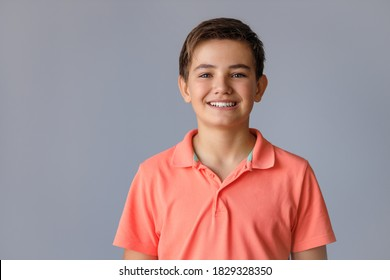 Portrait of a teenager 12-13 years old with different emotions on a gray background