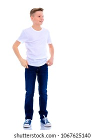 Portrait of a teenager boy in full growth in the studio on a white background. The concept of advertising, promotion of goods. Isolated.