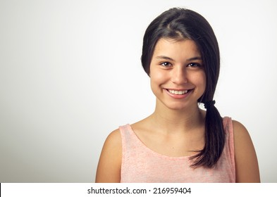 Portrait of a teenager brunette girl with happy smiley face