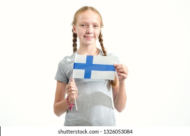 Portrait of a teenager girl with the flag of Finland on a light background. Scandinavian people.