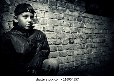 portrait of a teenager on a background of an old brick wall