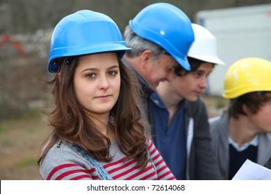 Portrait of teenager with security helmet