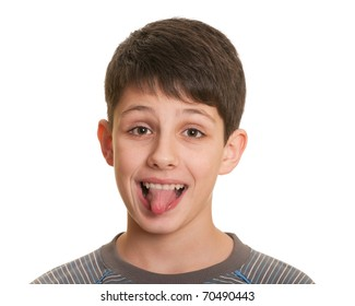 Portrait of a teenager showing his tongue; isolated on the white background