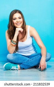 portrait of teenager style female smiling model sitting on floor . pretty woman full body portrait