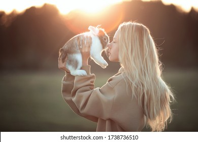 Portrait of teenagers with a rabbit in profile. Image with selective focus and toning.