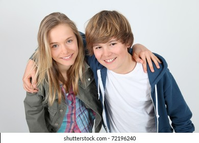 Portrait of teenagers standing on white background