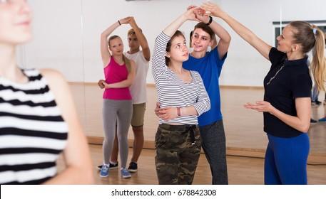 Portrait of teenagers studying of partner dance at dance school