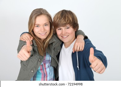 Portrait of teenagers with thumbs up