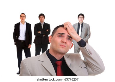 Portrait of a tensed young business man with hand on the face and team on background