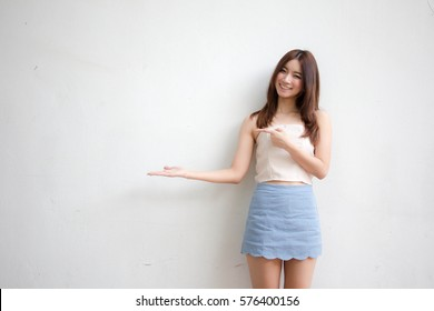 Portrait of thai adult beautiful girl pointing