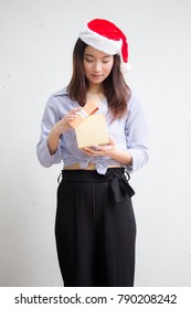 Portrait of thai adult beautiful girl hold gift box in hands
