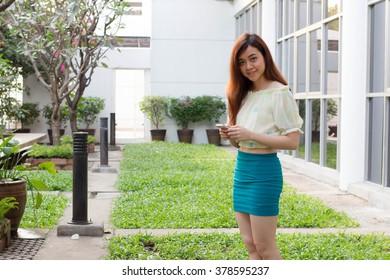 Portrait of thai adult businesswoman beautiful girl using her smart phone.