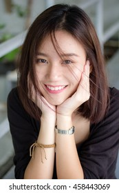 Portrait of thai adult glasses beautiful girl relax and smile