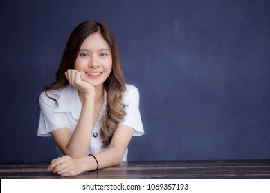 Portrait of thai adult student university uniform beautiful girl relax and smile