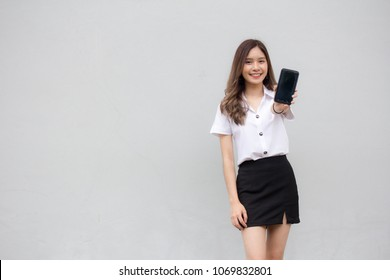 Portrait of thai adult student university uniform beautiful girl show her smart phone