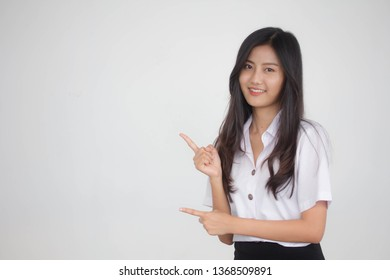 Portrait of thai adult student university uniform beautiful girl pointing