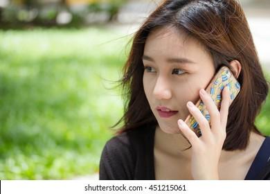 Portrait of thai adult student university beautiful girl calling smart phone