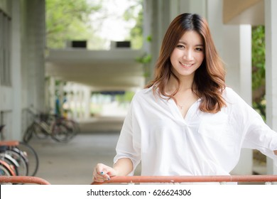 Portrait of thai china white shirt adult beautiful girl relax and smile