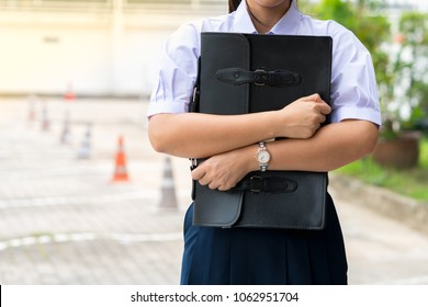 Portrait of thai high school student uniform teen beautiful girl happy and holding bag student Thailand