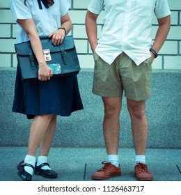 Portrait of thai high school student uniform teen boy and girl happy and holding bag student Thailand, process color.