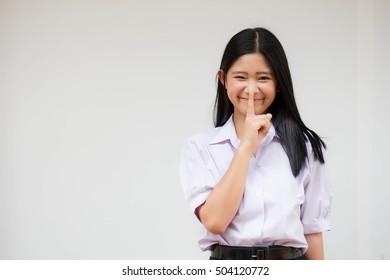 Portrait of thai high school student uniform beautiful girl silently
