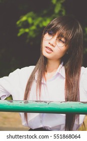 Portrait of thai high school student uniform teen glasses beautiful girl happy and relax