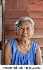 Portrait of Thai Senior woman is small smile with a bright and happy face in her home at Thailand.