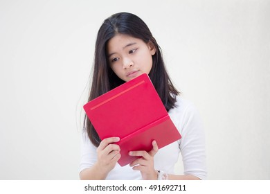 Portrait of thai teen beautiful girl and red book