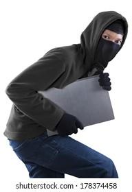 Portrait of a thief stealing a laptop computer