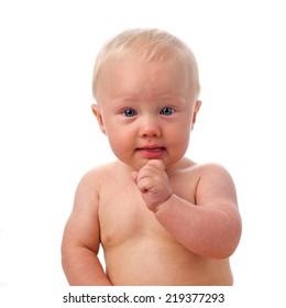 Portrait of thinking baby boy, soft focus