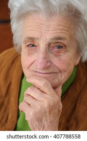 Portrait of a thinking elderly woman