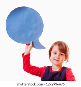 Portrait of thinking little child girl with thinking bubble blackboard background.
