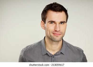 Portrait of a thinking man at grey shirt
