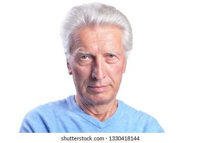 Portrait of thinking senior man on white background