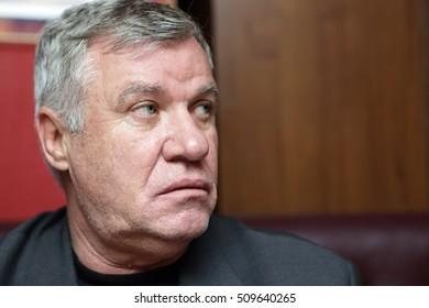 Portrait of a thinking senior man in a pub