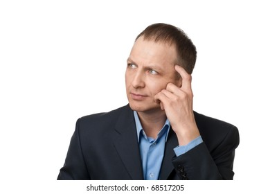 Portrait of a thinking successful businessman over white background