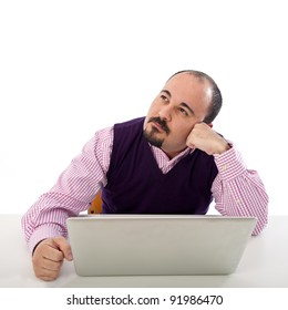 Portrait of thinking young man looking at laptop against white background.