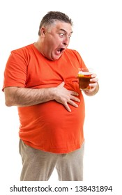 Portrait of a thirsty fat man staring at a glass of beer isolated on white background