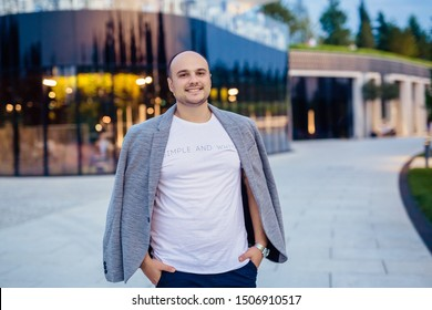 Portrait of a thirty year old man in a jacket against a restaurant