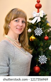 Portrait of the thirty-year-old woman about a New Year tree