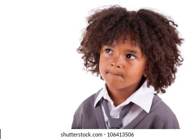 Portrait of a thoughtful african american little boy,isolated on white background