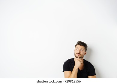 Portrait of thoughtful bearded man against white background