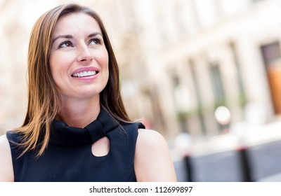 Portrait of a thoughtful business woman smiling