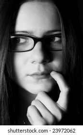 Portrait of the thoughtful girl in glasses