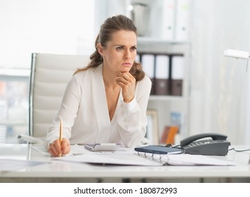 Portrait of thoughtful modern business woman in office